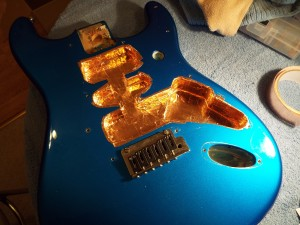 That looks a bit better! - Fender USA Stratocaster with copper cavity shielding installed.