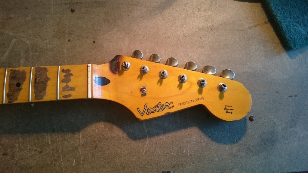 The headstock of a 1993 Vester Stratocaster - Aged by Tonefinder