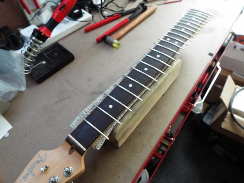 All the frets are now installed